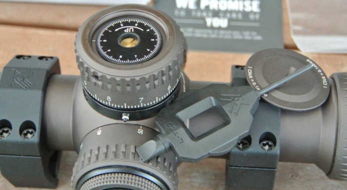 Vortex Razor HD II 4.5-27x56mm showing L-Tec elevation knob with cover removed, revolution indicator showing second revolution, and supplied adjustment tool