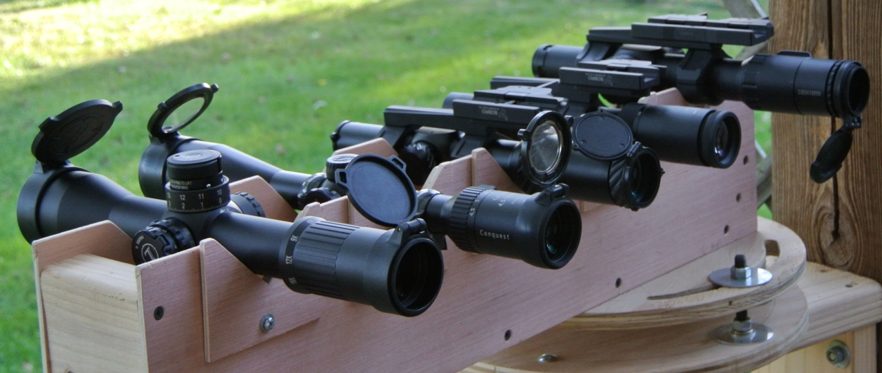 The comparison lineup from left to right- Leupold MK6 3-18x44, Zeiss Conquest 4.5-14x44, Optisan CX6 1-6x, Norden Performance GRSC CRS 1-6x, and Minox ZP8 1-8x, *Elcan Specter DR 1/4x  not pictured*